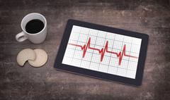Electrocardiogram on a tablet - Concept of healthcare - stock photo