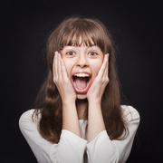 Portrait of young girl very emotionally responsive to surprise Stock Photos