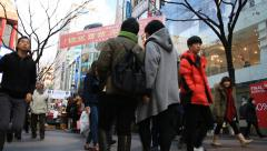 People walking around famous shopping district, Myeongdong street Stock Footage