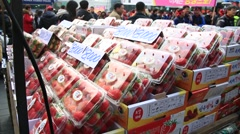 Fresh strawberries in plastic boxes on sale at kiosk at Myeongdong street Stock Footage