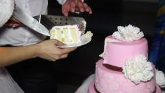 A piece of pink wedding cake Stock Footage