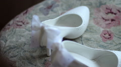 White female wedding shoes on chair Stock Footage