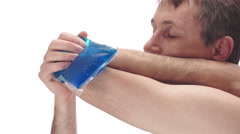 Man With Cold Pack on Elbow Side View Stock Footage