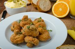 Breaded fried mushrooms with juice - stock photo