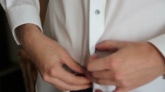 Man buttoning his shirt Stock Footage