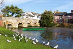 Christchurch Dorset England UK with bridge and green boat Stock Photos