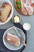 Parma ham on rustic bread - stock photo