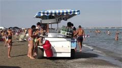 MAN SELLING DRINKS ON BEACH, LIDO, VENICE, ITALY - stock footage