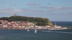 YACHTS & SPEED BOAT, SOUTH BAY, SCARBOROUGH, YORKSHIRE ENGLAND - stock footage
