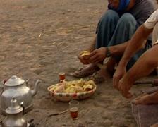 Berber man eating bread Stock Footage