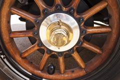 Automobiles wooden wheel. - stock photo