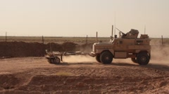 MRAP with mine sweeper clearing road  Stock Footage