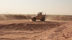 Two MRAP leaving military base,Iraq Stock Footage