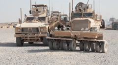 Stock Video Footage of Armored vehicles MRAP parked at military base in Afghanistan