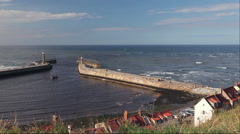REPLICA OF CAPTAIN COOKS ENDEAVOR & TWIN PIERS, WHITBY, NORTH YORKSHIRE Stock Footage