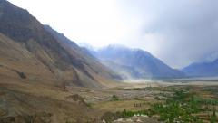 Panorama of the avalanche and the beginning of a storm in the valley of Nubra Stock Footage