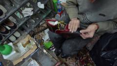 Shoe maker master craftsman manufacture produce man shoe small atelier Stock Footage