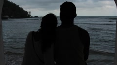Couple hugging looking at the sea in afternoon, Panama - stock footage