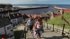 199 STEPS TO ABBEY & TWIN PIERS, WHITBY, NORTH YORKSHIRE Stock Footage