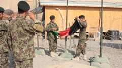 US and Afghan Simultaneous Flag Raising at Military Base Stock Footage