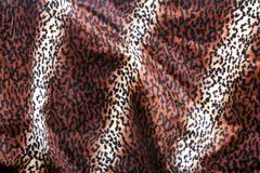 Faux Leopard Print Pattern on Furry Fabric - stock photo