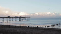 Sunset at Teignmouth Beach and Pier - Wide Shot - Beautiful view of a calm Sea Stock Footage