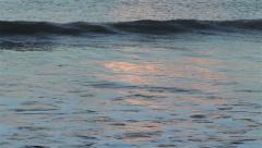Beautiful Light from Sunset reflecting in the waves of the sea Stock Footage