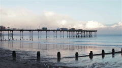 Sunset at Teignmouth Pier - Wide Shot - Beautiful view of a calm Sea Stock Footage