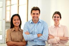 Enterpreneur team crossing hands and smiling - stock photo