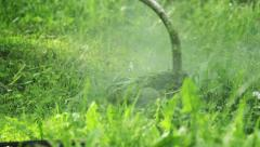 Trimming the grass, grass-cutter Stock Footage