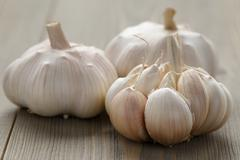 Fresh garlic on wood table Stock Photos