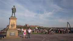 CAPTAIN COOK STATUE &  WHALE BONE ARCH, WHITBY, NORTH YORKSHIRE Stock Footage