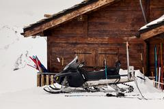 Snowmobile rescuers in the mountains Stock Photos