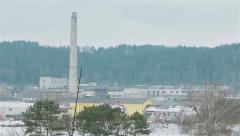 Winter view of old inactive factory not in use with smokestack in the middle. Pa Stock Footage