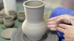 Potter makes pitcher from clay Stock Footage