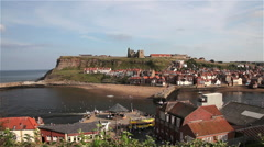 EAST CLIFF HARBOUR & BEACH, WHITBY, NORTH YORKSHIRE, ENGLAND Stock Footage