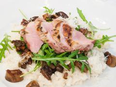 Pork tenderloin with rissoto Stock Photos