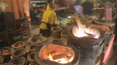 Open fire cooking clay pots Stock Footage
