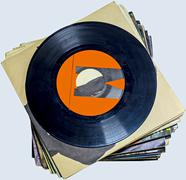 A pile of 45 RPM vinyl records used and dirty even if in good condition Stock Photos