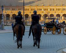 "Seville, Spain - August 22, 2012: Two police on horseback patrol the ""Plaza o - stock photo"