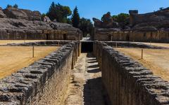 View of the ancient roman amphitheater of Italica, an archeological complex i Stock Photos