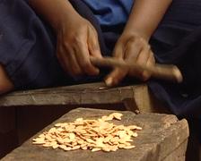 Bantu peeling almonds Stock Footage