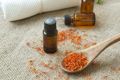 Saffron  essential oil - stock photo