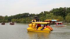 Pleasure boat on slender west lake Stock Footage
