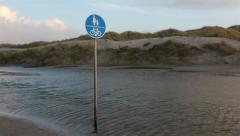 Pedestrian sign on a flooded beach Stock Footage