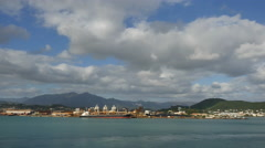New Caledonia Noumea waterfront and hills under long clouds Stock Footage