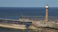 TWIN PIERS & STONE LIGHTHOUSE, WHITBY, NORTH YORKSHIRE, ENGLAND Stock Footage