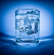 Glass of water with ice Stock Photos