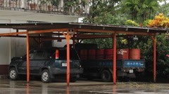 Imported Vehicles Under Car Park on the Micronesian Island of Pohnpei - stock footage