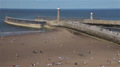 TWIN PIERS & ENTRANCE TO WHITBY HARBOUR, NORTH YORKSHIRE, ENGLAND Stock Footage